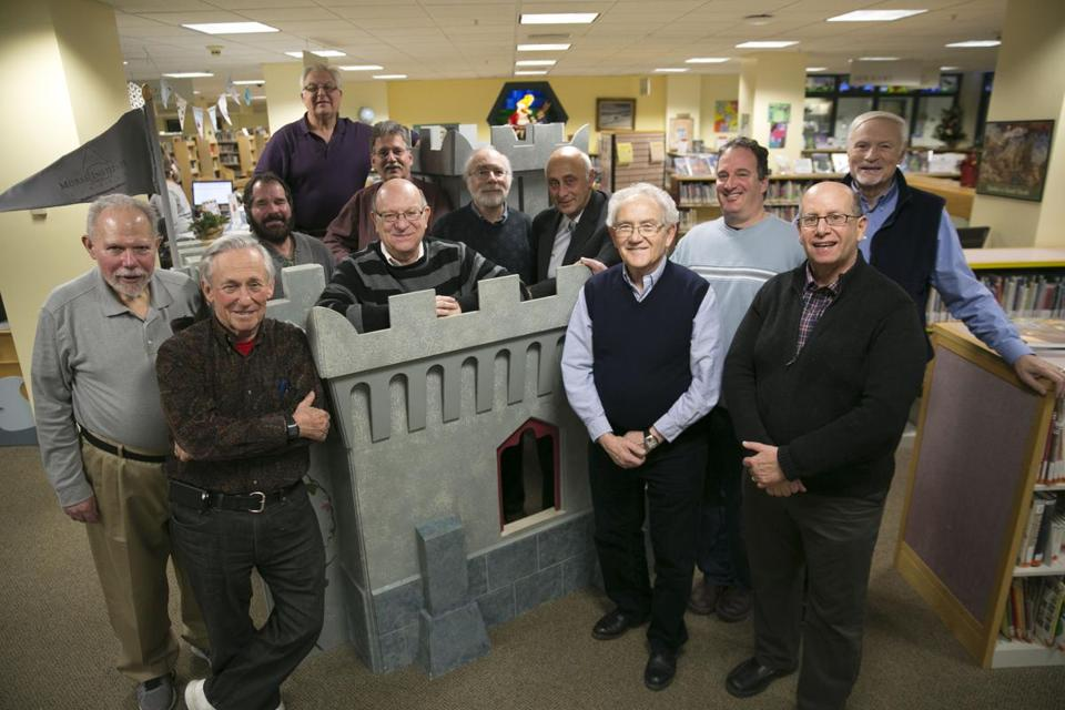 Members of Temple Israel in Natick (from left: Fred Merkowitz, Jay Ball, David Yarckin, Ben Greenberg, John Miller, Allen Block, Steve Friedman, Alex Eventov, Israel Michaeli, David Jacobs, Al Schneider, and Dubi Gordo) display an indoor play structure/puppet theater they made for Morse Institute Library.