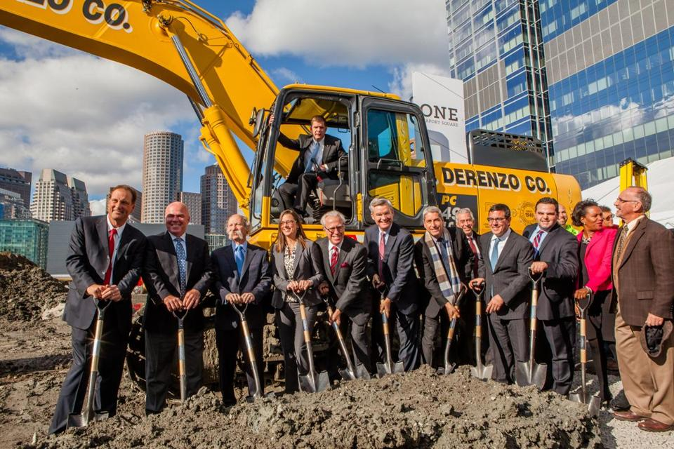 Mayor Martin J. Walsh took the controls of an earthmover while other dignitaries grabbed shovels to launch a building at One Seaport Square.