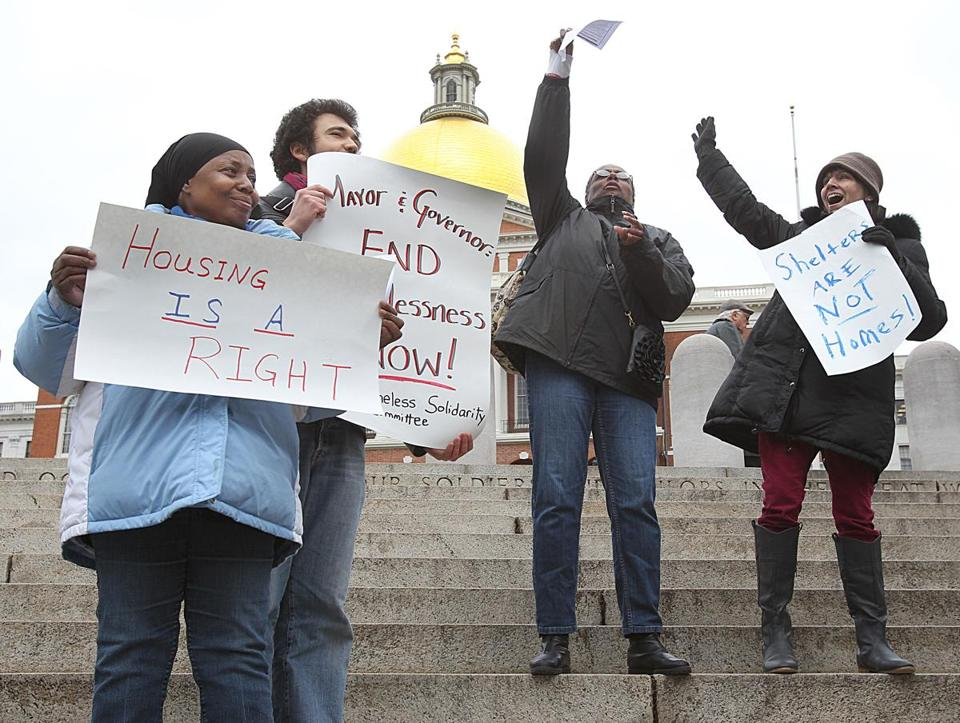 Alise Lewis (left), Lang Haynes, Ronda Jackson, and Karen Kenney were among advocates and former homeless people who demonstrated in front of the State House on Friday.