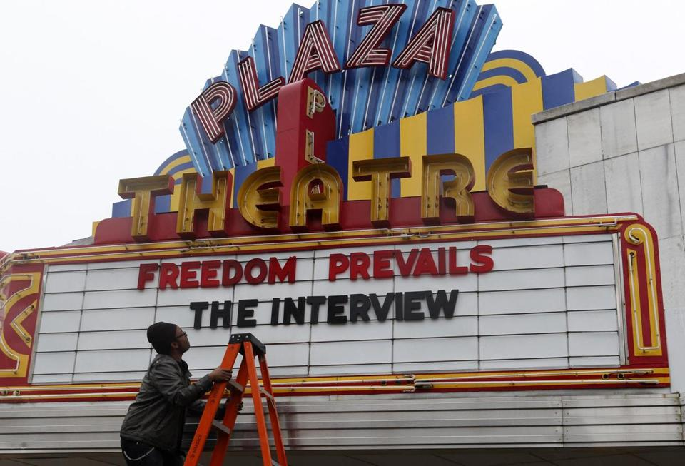 "A movie theater's marquee celebrates ""The Interview."""