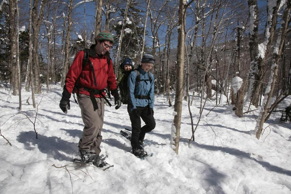 Snowshoeing is just one of the activities  on the agenda at Appalachian Mountain Club lodges. (Herb Swanson/Appalachian Mountain Club) 06kids