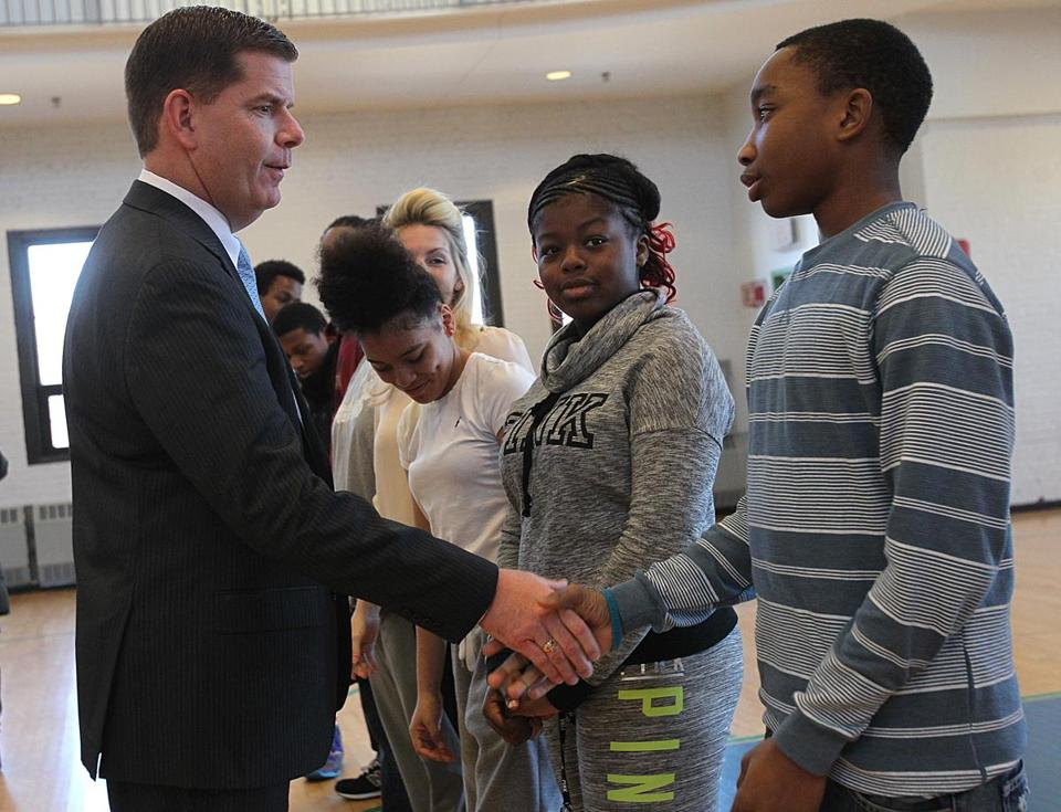 Roslindale, MA., 12/26/14, Mayor Marty Walsh greets Boston middleschool student Vanell Dominique , cq, before the press conference. The Mayor the Boston Public Schools and the BTA negotiate a plan to extend the school day 40 minutes. Section: Metro Suzanne Kreiter/Globe staff