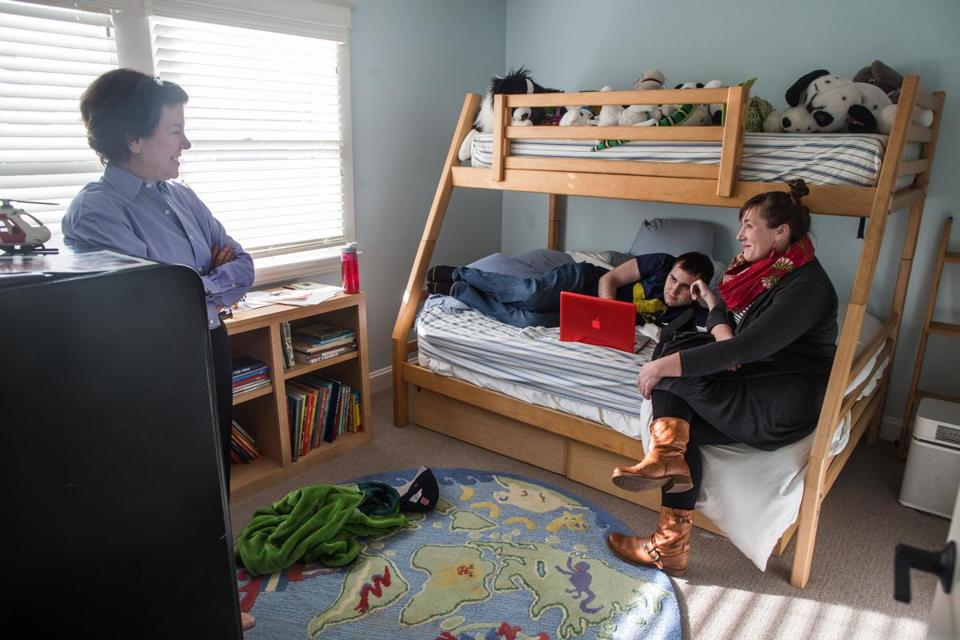 12/30/2014 SOMERVILLE, MA L-R Deborah Flaschen (cq) her autistic son DJ Flaschen (cq) 24, and his art therapist Meghan Montgomery (cq) talk together in his room at 3LPlace Life College Residence in Somerville. (Aram Boghosian for The Boston Globe)