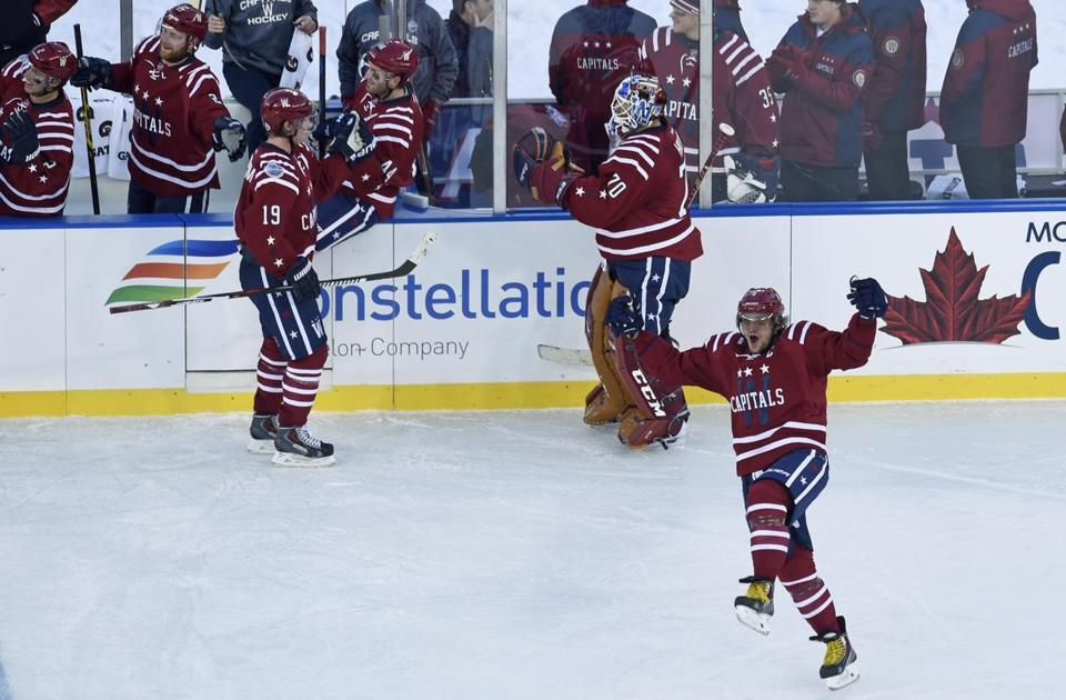 Capitals left wing Alex Ovechkin celebrates the game-winning goal by  teammate Troy Brouwer during 8a03d7fa5