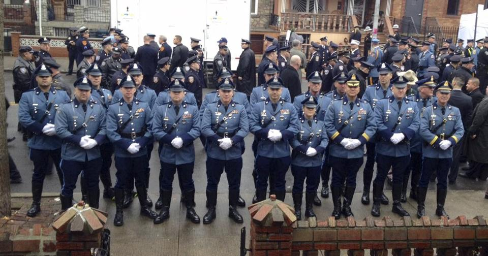 Local Officers Join New York Police In Mourning Slain