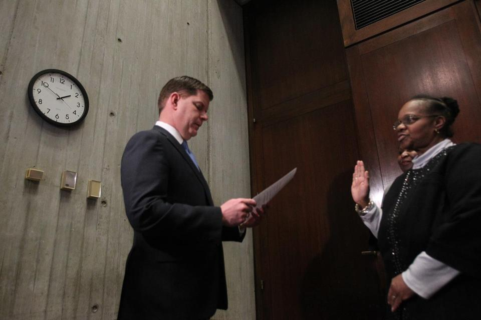 Boston Mayor Martin J. Walsh swore in Jeri Robinson to the school committee in 2014.