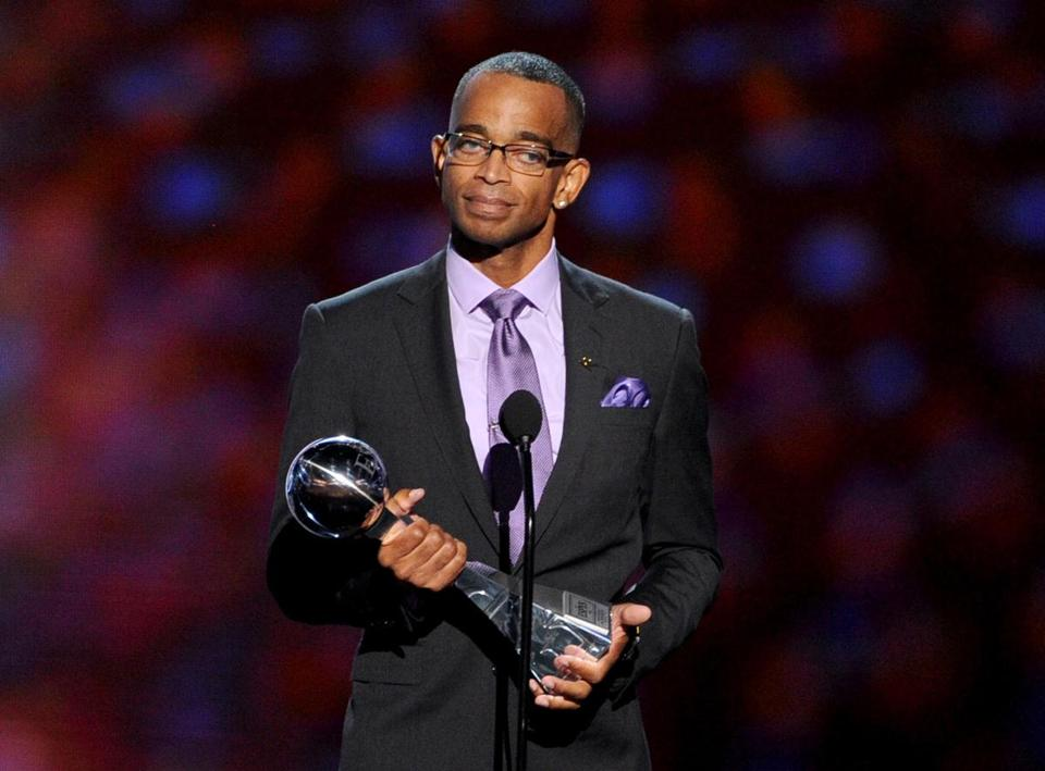 FILE JANUARY 4, 2015: Longtime ESPN Anchor Stuart Scott died on January 4, 2015 at the age of 49. His death was caused by an undisclosed form of cancer. He was diagnosed with cancer in 2007. LOS ANGELES, CA - JULY 16: TV personality Stuart Scott accepts the 2014 Jimmy V Perseverance Award onstage during the 2014 ESPYS at Nokia Theatre L.A. Live on July 16, 2014 in Los Angeles, California. (Photo by Kevin Winter/Getty Images)