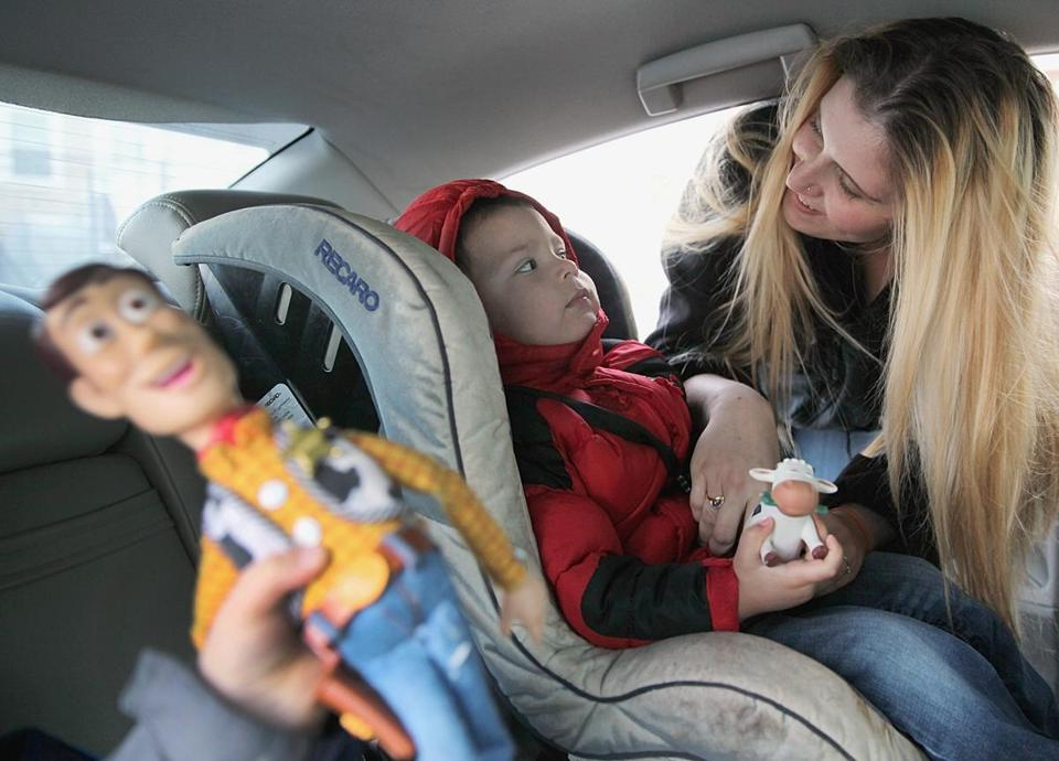 Lindsey Collins, shown with her 2-year-old son, Julian, spent a night on a Quincy beach with her older child before she could find a temporary home.