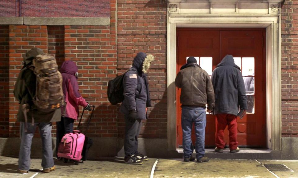 Homeless people wait to be admitted to the Boston Night Center last January.