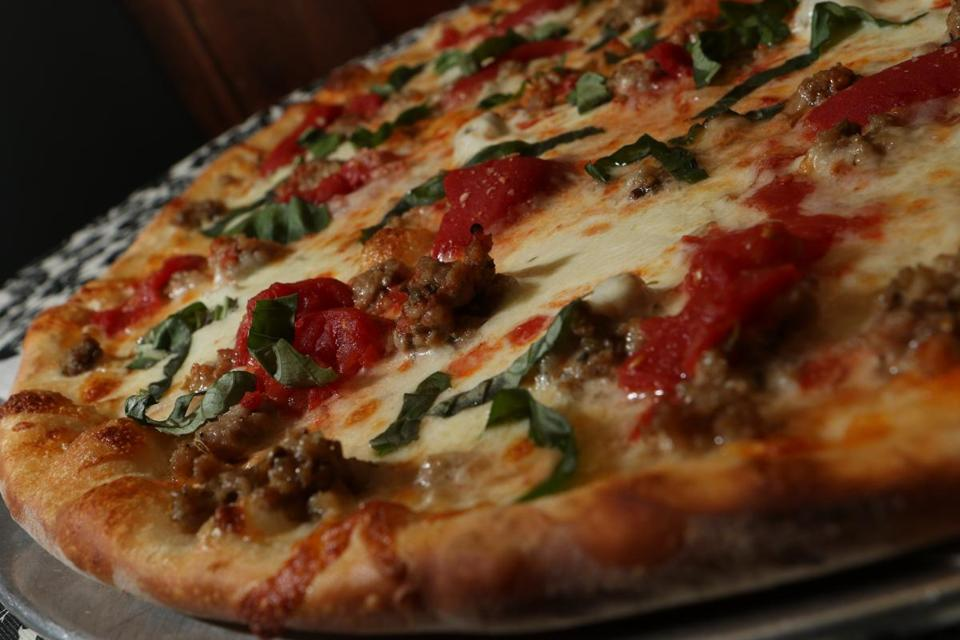 The Sienna pizza is topped with  crumbled, house-made pork sausage woven with fennel, coriander, and paprika.