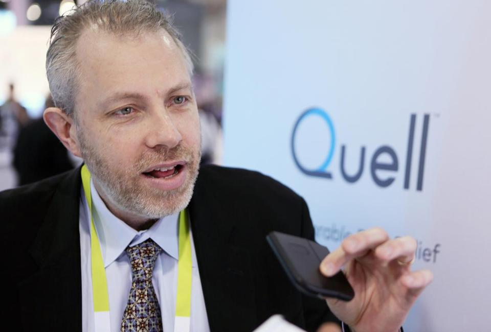 14neurometrix - Dr. Shai Gozani, president and chief executive officer of NeuroMetrix, holds a wearable pain relief technology device called Quell while speaking during an interview at the Consumer Electronics Show Wednesday, Jan. 7, 2015, in Las Vegas. Quell, which is designed by Waltham-based NeuroMetrix, is assembled and manufactured in Massachusetts. (Ronda Churchill for The Boston Globe)