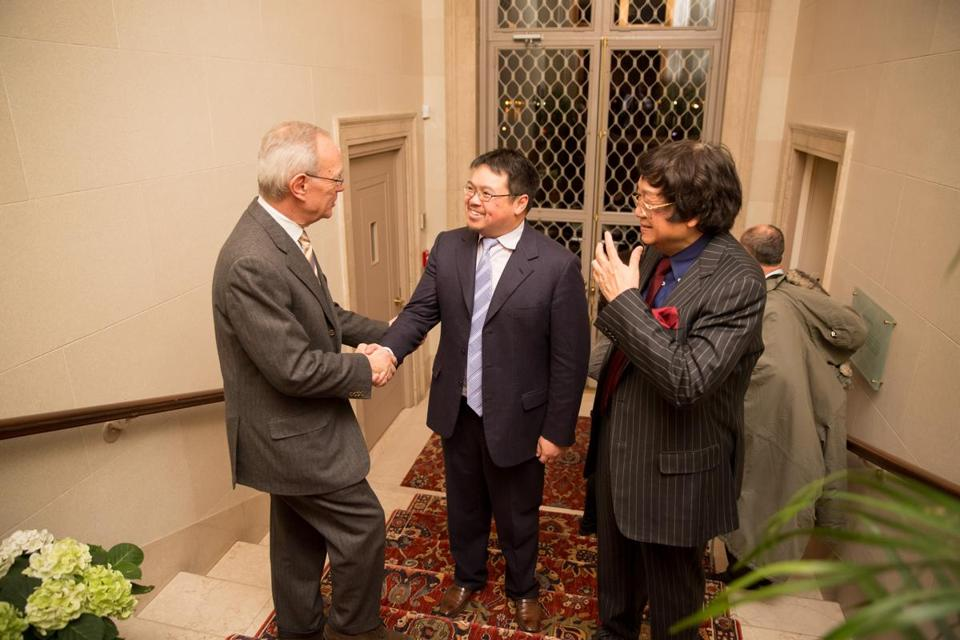 MIT President L. Rafael Reif greets Samathur Li (center), son of Samuel Tak Lee (right), who donated $118 million to the school for a real estate entrepreneurship lab.