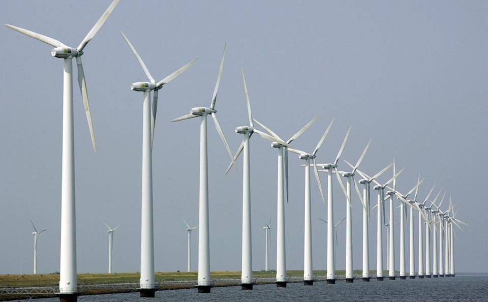FILE - In this July 27, 2006 file photo, wind turbines stand clustered offshore in Dronten, the Netherlands. U.S. Interior Secretary Ken Salazar will announce Wednesday, April 28, 2010, his decision whether the Cape Wind project can proceed off the Cape Cod coast in Massachusetts, clearing the way for the construction of a 130-turbine wind farm in the Nantucket Sound. (AP Photo/ Peter Dejong, File)