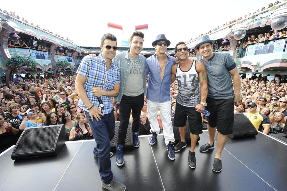 "New Kids (from left) Jordan Knight, Jonathan Knight, Donnie Wahlberg, Danny Wood, and Joey McIntyre on their ""Rock This Boat"" cruise, which turned into a reality TV show."