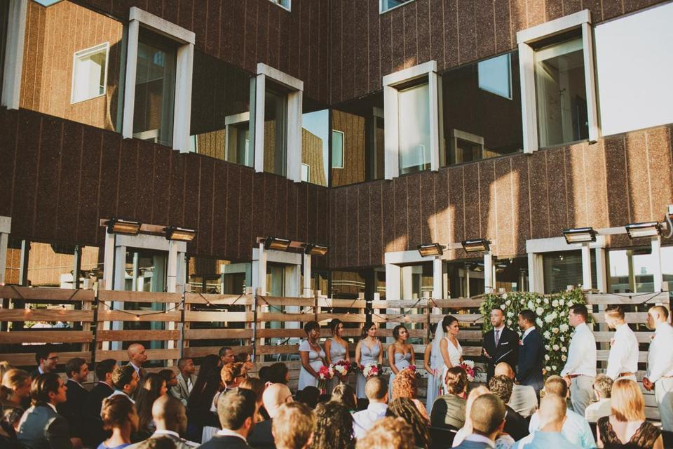 The late-summer vows took place on the roof-deck patio.