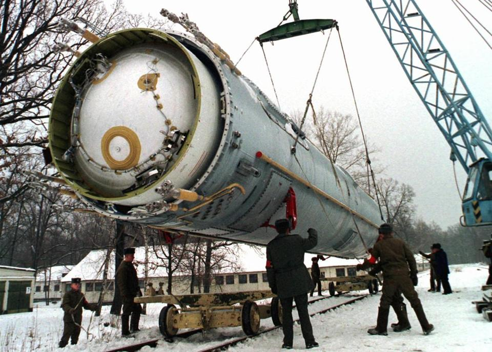 18loosenukes - In this Wednesday, Dec. 24, 1997 file photo, soldiers prepare to destroy a ballistic SS-19 missile in the yard of the largest former Soviet military rocket base in Vakulenchuk, Ukraine, 220 kilometers (137 miles) west of Kiev. The U.S. helped Ukraine and other ex-Soviet nations secure former Soviet nuclear weapons and dismantle some of them under the Cooperative Threat Reduction Program initiated by Sens. Sam Nunn and Richard Lugar. (Associated Press)