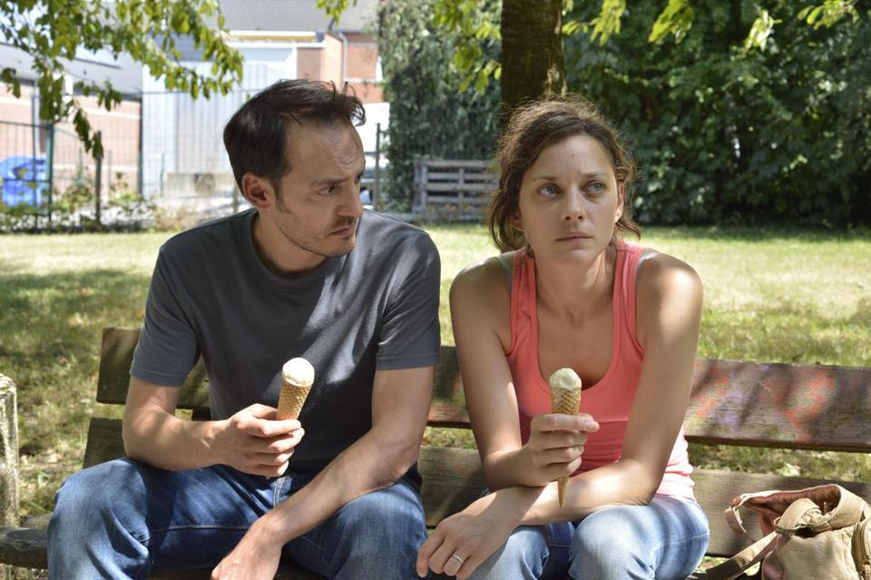 Fabrizio Rongione and Marion Cotillard in the 2014 Belgian film TWO DAYS, ONE NIGHT, directed by Luc Dardenne and Jean-Pierre Dardenne. Copyright Christine Plenus. A Sundance Selects release.