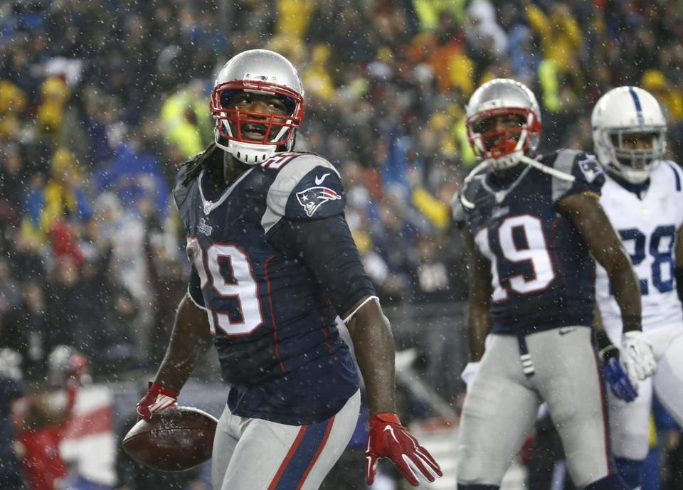 After LeGarrette Blount ran for a touchdown in the third quarter, Brandon LaFell (19) grabbed the football and handed it to a fan.