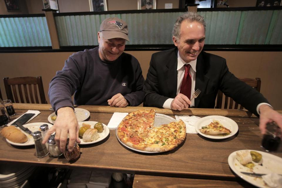 East Boston, MA - 01/20/15 - Gary Clemons (left) and Tom Amoroso grew up together down the street, and still meet to share a pie at Santarpio's in East Boston. Lane Turner/Globe Staff Section: MAG Reporter: francis storrs Slug: 020815BestPizza