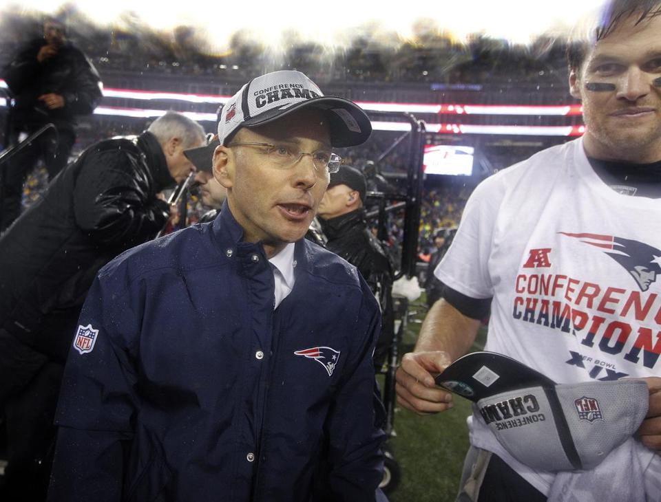 Jonathan Kraft (left) is pictured with quarterback Tom Brady (right) after winning the AFC Championship.