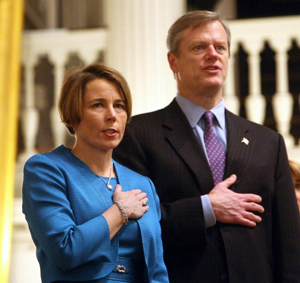01-21-2015: Boston, MA: Maura Healey (left) and Gov. Charlie Baker during the Pledge of Allegiance during ceremony where Healey was sworn in as Massachusetts Attorney General at Faneuil Hall in Boston, Mass. January 21, 2015. Photo/John Blanding, Boston Globe staff story/David Scharfenberg, Metro ( 22healey )