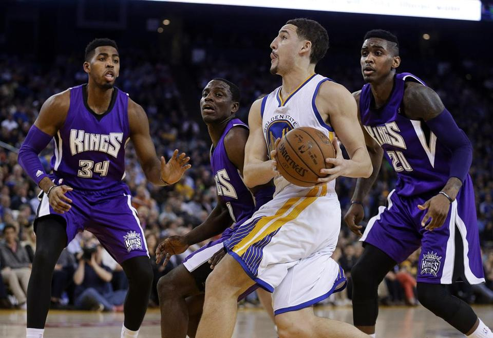 Kings Jason Thompson (34), Darren Collison and Quincy Miller  were no match for the hot hand of Warriors guard Klay Thompson.