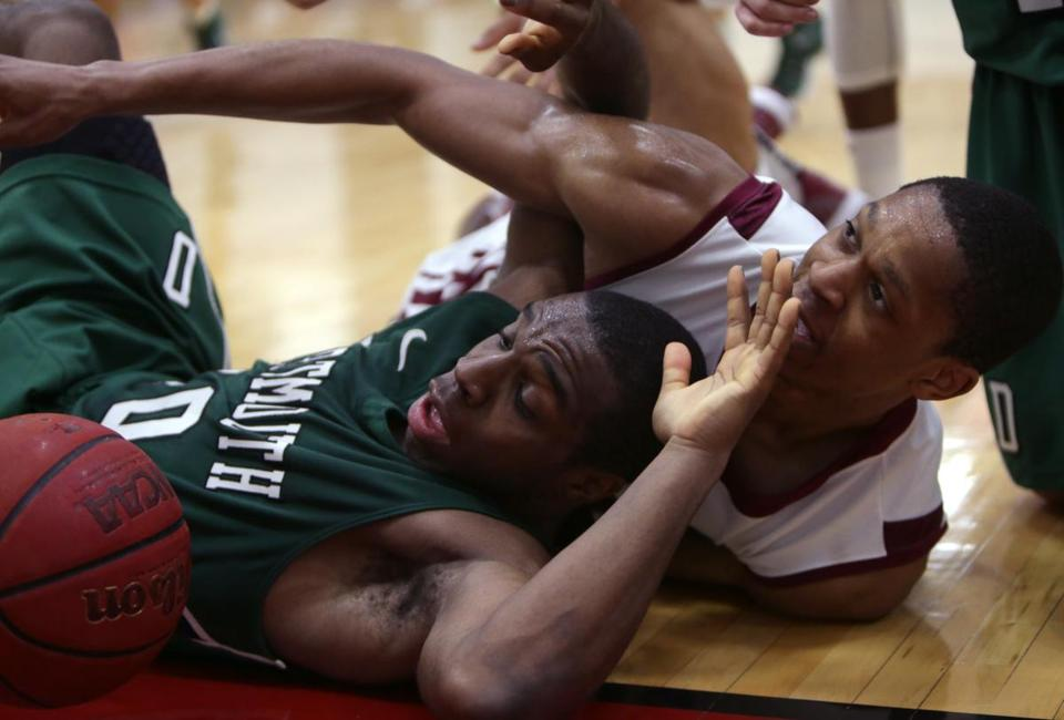 Harvard guard Agunwa Okolie looked for an out-of-bounds call as he battled with Dartmouth's Malik Gill on the floor.