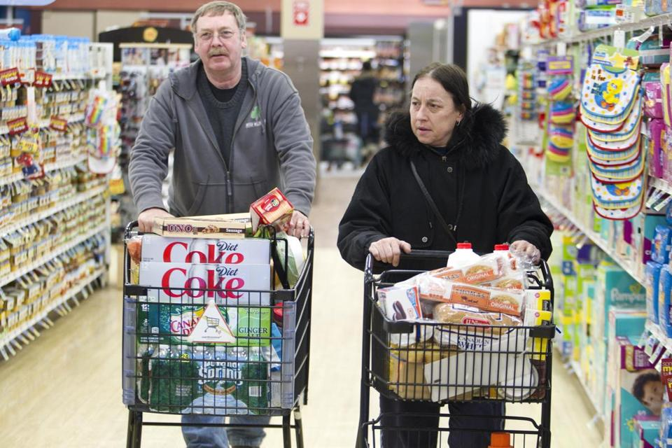 At right, Cheryl and Bill Keough of South Boston were among many stocking up for the concoming storm.