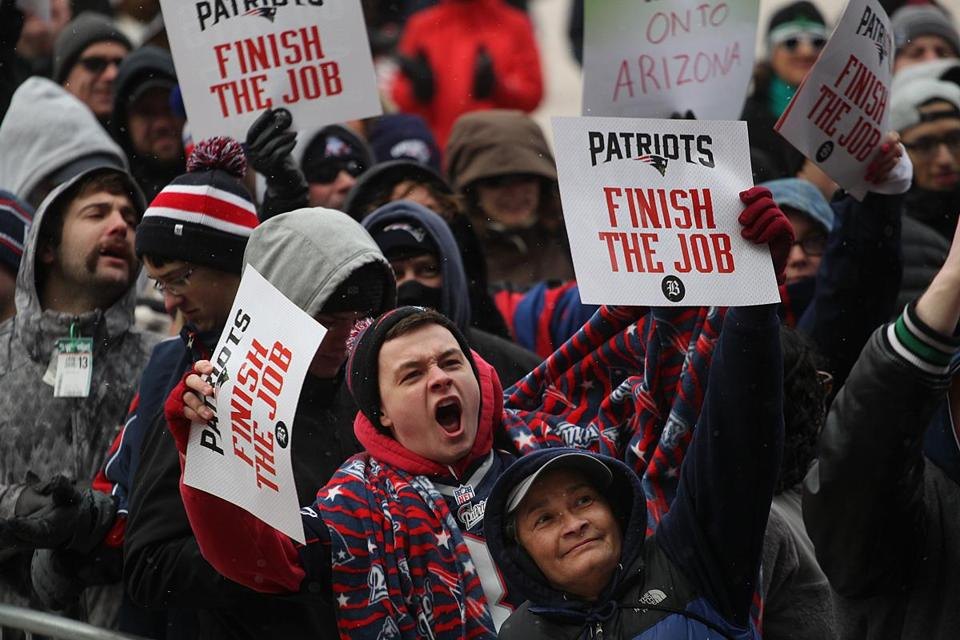 The bitter cold and biting winds were no match for the warm enthusiasm of Patriots fans in City Hall Plaza.