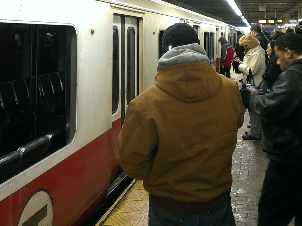 Bystanders kicked in windows to help passengers out of a smoke-filled Red-Line train at Quincy Station.