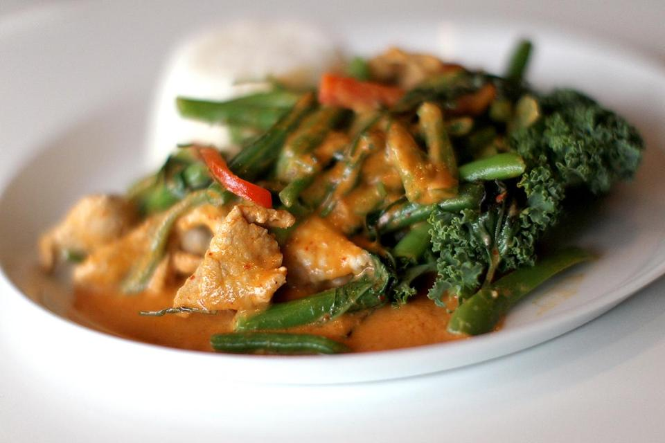 Manita Bunnagitkarn (below) offers Thai dishes such as Panang curry with pork (left) and  chicken satay (above).