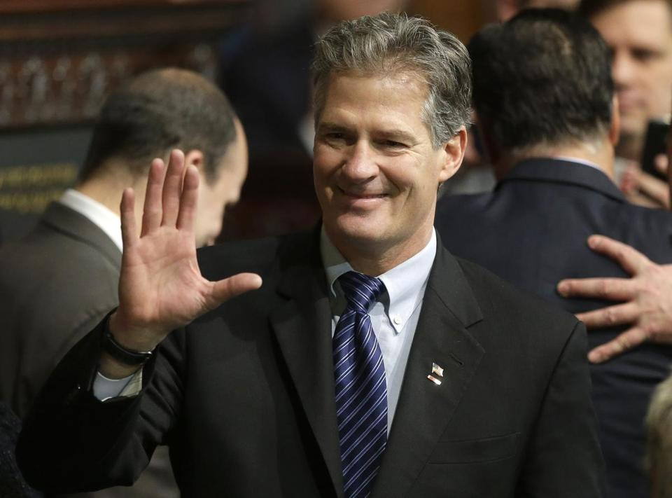 Former U.S. Sen. Scott Brown greeted people on the floor of the House Chamber at the Statehouse.