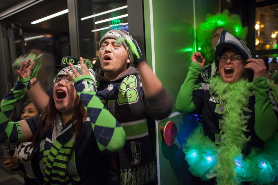 SEATTLE, WA - FEBRUARY 1: Seattle Seahawks fans (L-R) Sheila Delrio, Michael Delrio and Megan Whitaker react late during Super Bowl XLIX at Quality Athletics on February 1, 2015 in Seattle, Washington. Fans gathered in homes and bars across the city to watch the Seahawks take on the New England Patriots. (Photo by David Ryder/Getty Images)
