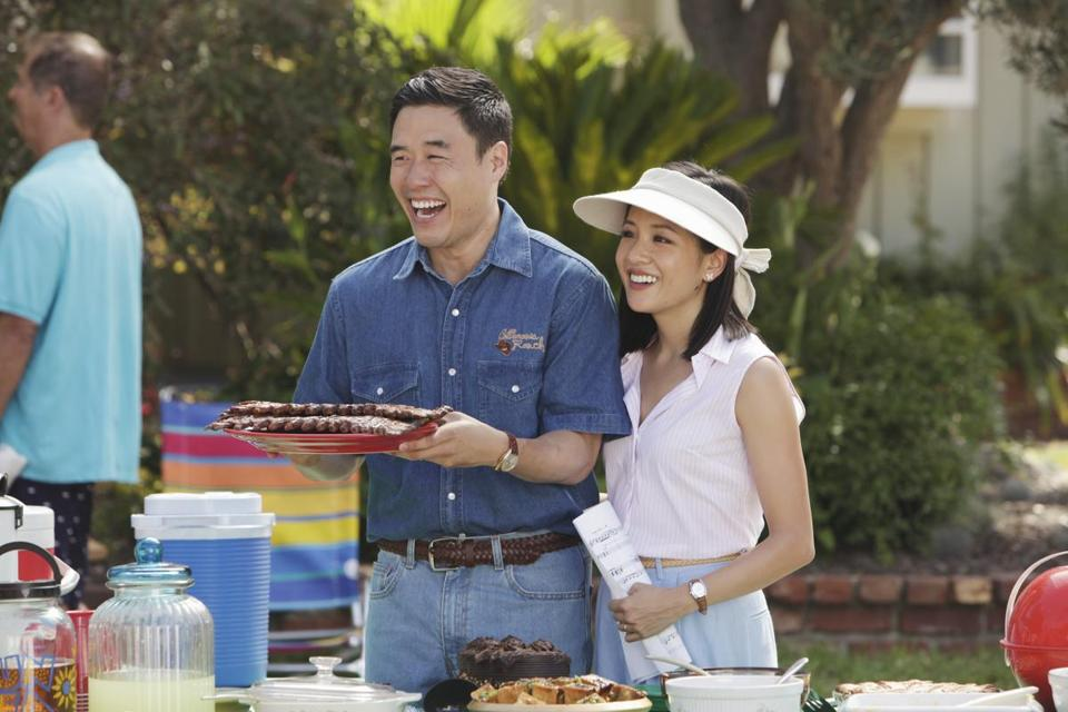"Randall Park (left) and Constance Wu in a scene from ""Fresh Off the Boat."""
