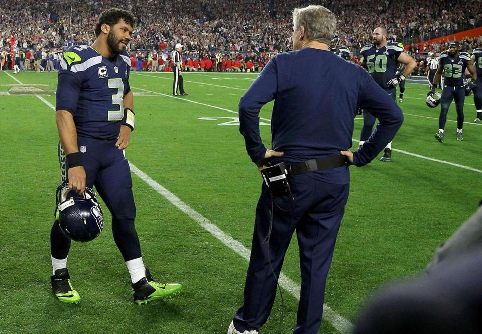 Seattle Seahawks head coach Pete Carroll and quarterback Russell Wilson (3) talk after being intercepted by New England Patriots strong safety Malcolm Butler in the final seconds of the NFL Super Bowl XLIX football game in Glendale, Arizona February 1, 2015. REUTERS/Brian Snyder (UNITED STATES - Tags: SPORT FOOTBALL)
