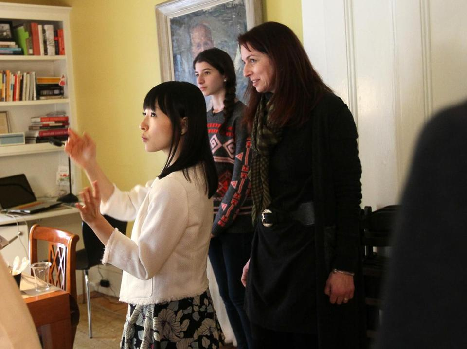 Marie Kondo tells Claudia Logan and her daughter Otti, 16, through an interpreter that there is much joy in their dining room. Kondo's book  has sold 2 million copies worldwide.