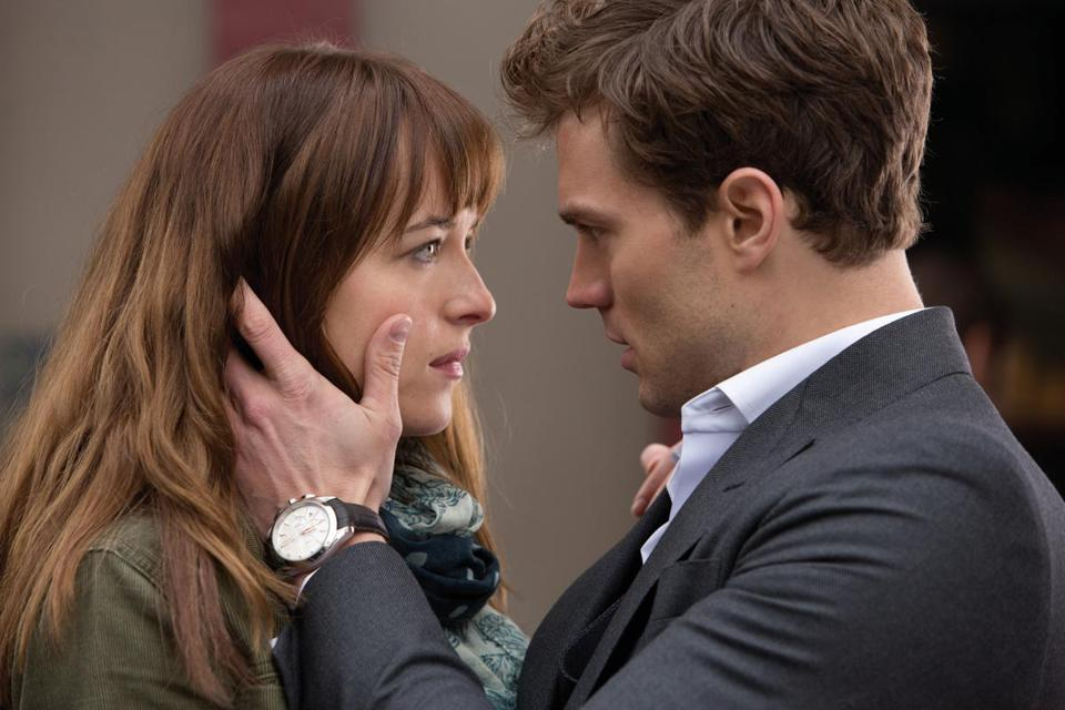Dakota Johnson and Jamie Dornan in the 2015 film FIFTY SHADES OF GREY, directed by Sam Taylor-Johnson.