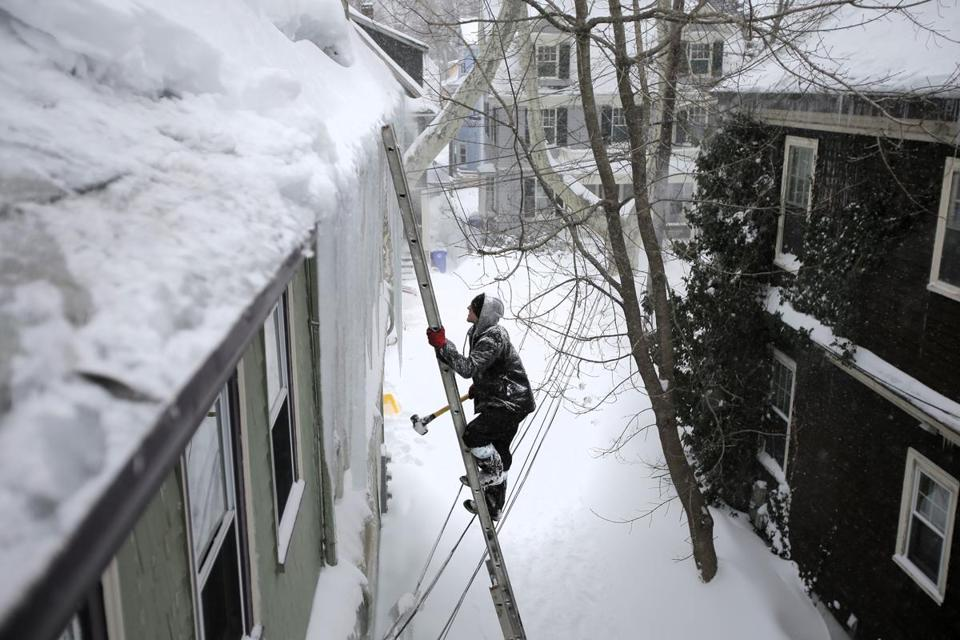 Jay Bullens Jr. Of Able Roofing Climbed A Ladder To Knock Snow And Ice Off