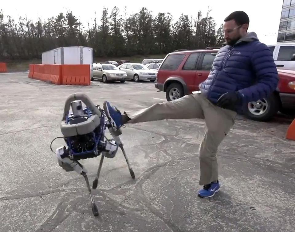 A Boston Dynamics employee kicked Spot, but the robot stayed upright.