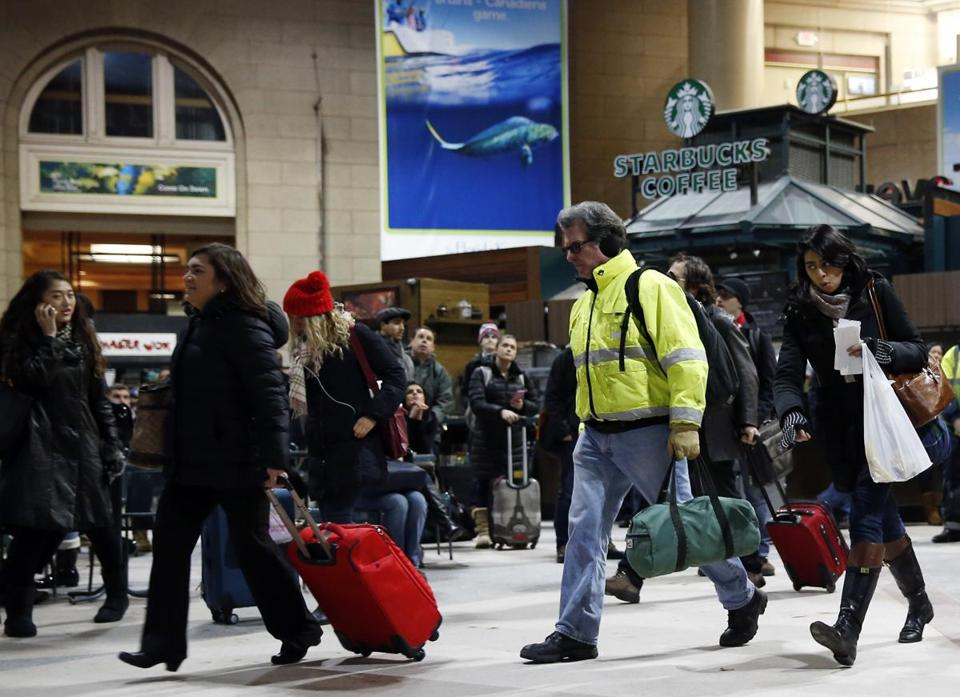 People rushed to catch their trains at South Station on Monday night before the rail shutdown.
