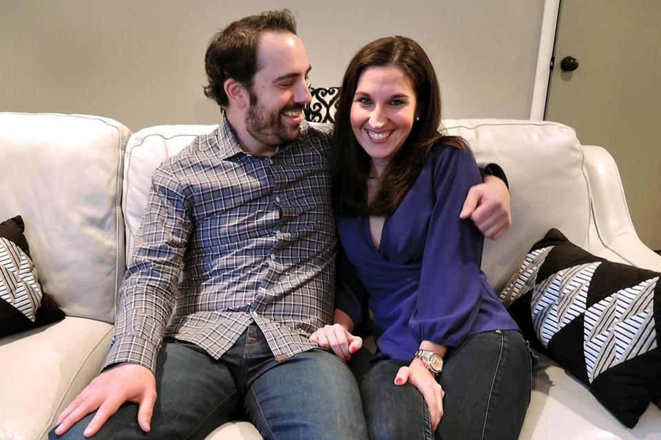 """My boyfriend just sent me a confirmation e-mail with tickets for Valentine's Day. I don't think he's a willing participant, but he's taking one for the team,"" said Meghan Daly, 29, from Avon, shown with her boyfriend, Paul Anderson."