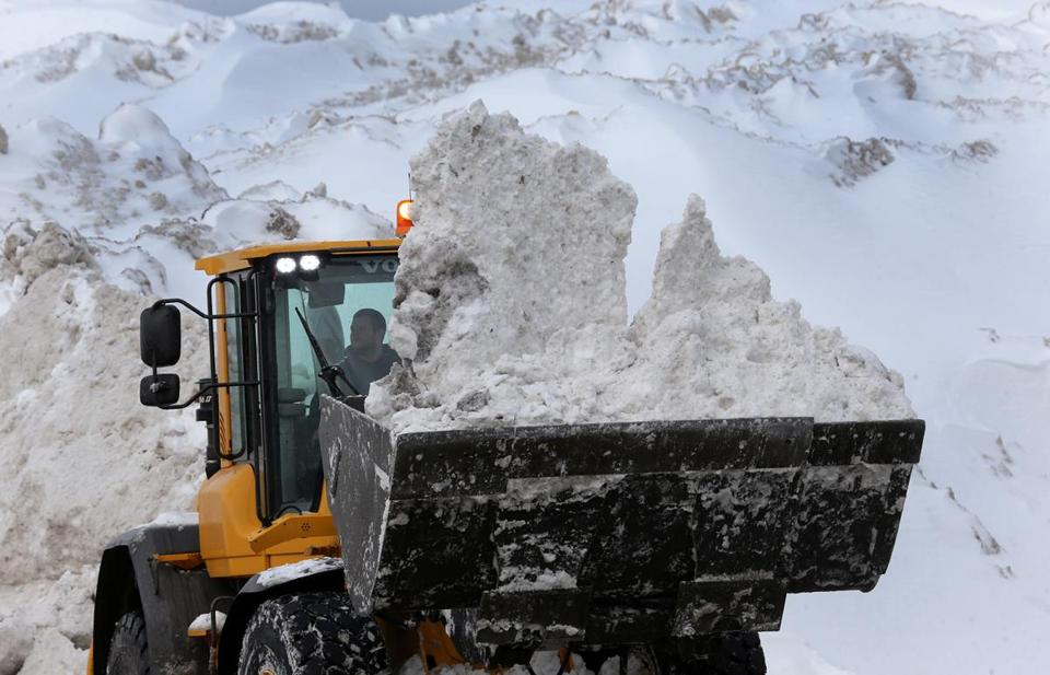 BOSTON, MA - 2/10/2015: Boston's snow farm keeps getting bigger seen here by the Seaport District in South Boston. With more snow present hitting close to records, Boston area just deal with it..... (David L Ryan/Globe Staff Photo) SECTION: METRO TOPIC stand aone