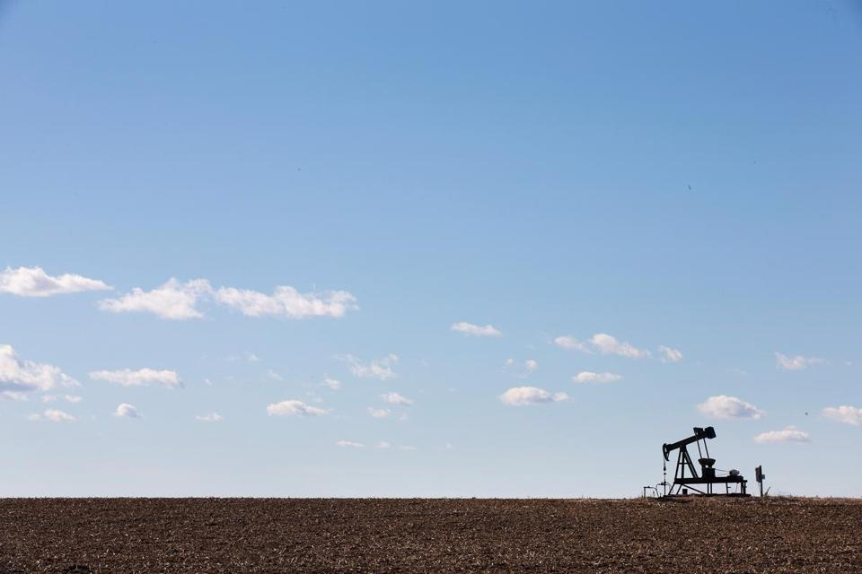 A pump jack, used to extract crude oil from the ground, sat above a well near Ridgway, Ill.