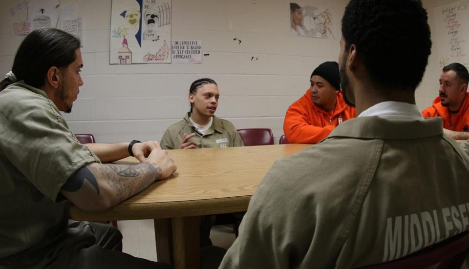 Middlesex County House of Correction inmate Angel Garcia, speaks during a group session with Johnny Chheng, and Jonathan Lunde of The United Teen Equally Center, and other inmates on Thursday February 12, 2015. Mark Lorenz for the Boston Globe