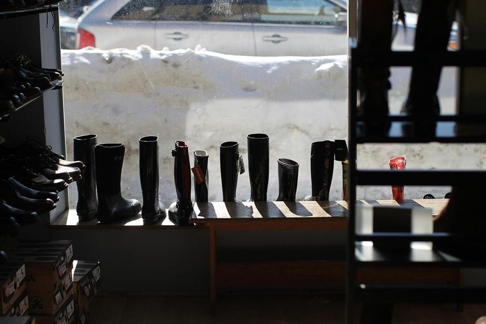 Even with winter boots for sale, Brookline's Downtown Shooz is feeling the pinch of reduced business because of the snow.