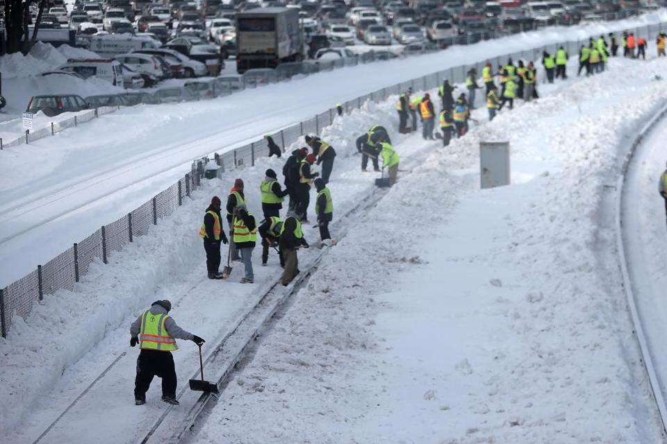 Quincy, MA - 02/17/15 - Crews shovel snow from MBTA Red Line tracks just outside the North Quincy T station Tuesday afternoon, February 17, 2015. Lane Turner/Globe Staff Section: METRO Reporter: typist Slug: