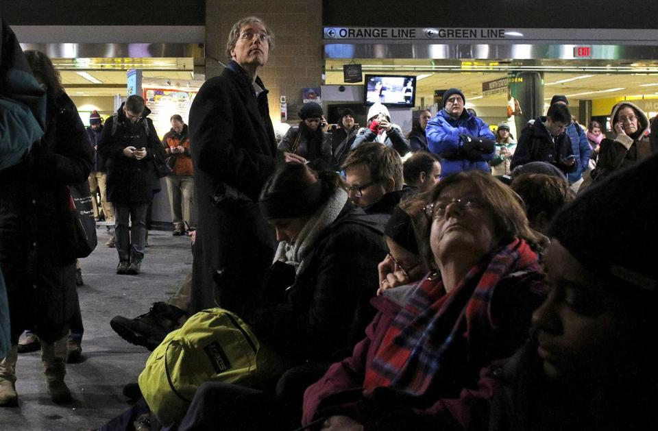 Commuters at North Station on Tuesday had long waits and precious little information.