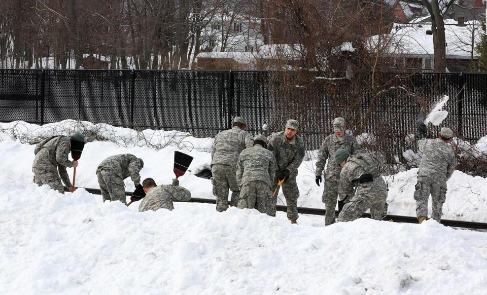 Massachusetts Army National Guard troops from the 181st Infantry worked to remove snow along the Red Line.