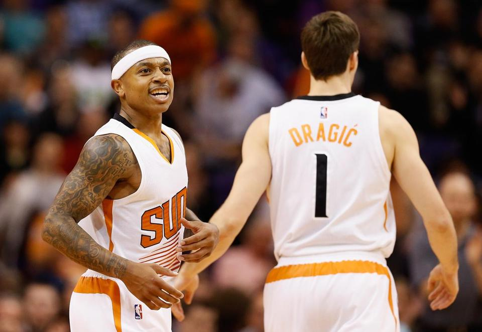 PHOENIX, AZ - JANUARY 21: Isaiah Thomas #3 of the Phoenix Suns celebrates with Goran Dragic #1 after scoring against the Portland Trail Blazers during the second half of the NBA game at US Airways Center on January 21, 2015 in Phoenix, Arizona. The Suns defeated the Trail Blazers 118-113. NOTE TO USER: User expressly acknowledges and agrees that, by downloading and or using this photograph, User is consenting to the terms and conditions of the Getty Images License Agreement. (Photo by Christian Petersen/Getty Images)