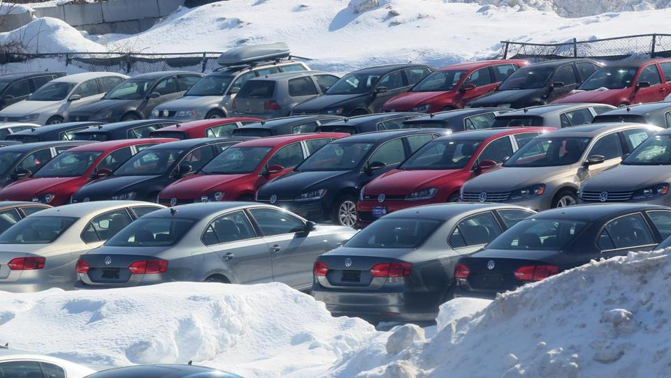 Cars and snow filled the lot at Colonial Volkswagen in Medford.